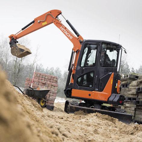 mini escavatore congolato con braccio